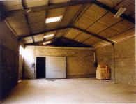 <br>Inside of farm building before transformation