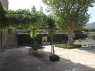 <br>The paved courtyard with fountain and trellis